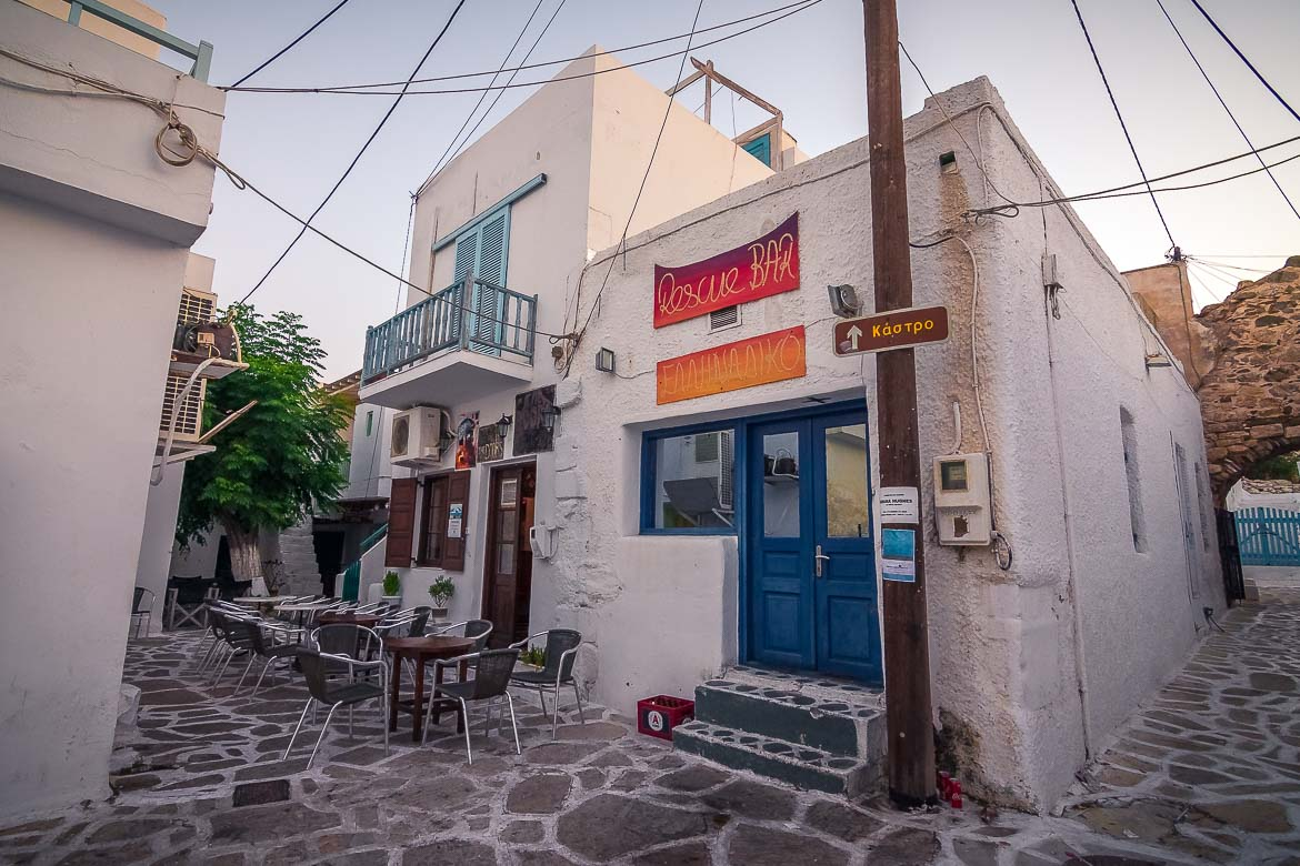 This photo shows a traditional building which houses two bars in Antiparos town. A rock music bar and a mainstream Greek music one.