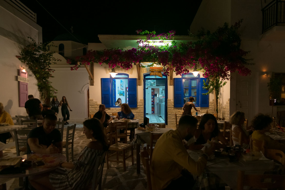 This is a night shot of the outside seating area at Plaza Souvlaki.