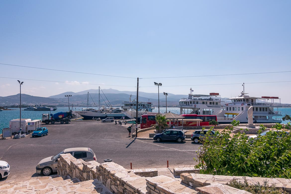 This is a panoramic shot of the port of Antiparos. There are three ferries in the sea and you can clearly see the coast of Paros across the narrow strait.
