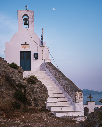 This is Agios Konstantinos church at the top of the Venetian Castle at sunset.