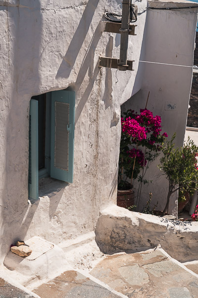This is a whitewashed narrow alley in Pano Chora Serifos.