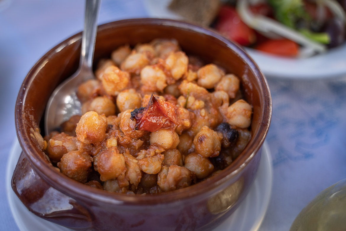 This is a close-up of an earthenware bowl filled with revithada, chickpea stew, one of the best things to eat in Serifos.