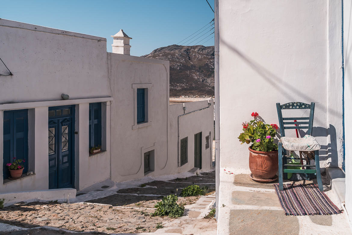This image shows a chair outside a traditional house in Kato Chora Serifos.