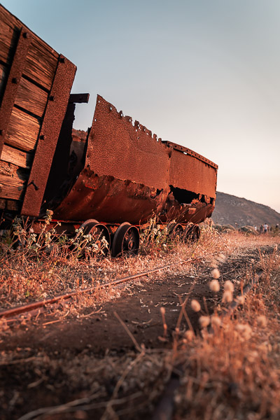 This image shows the abandoned wagons and rails at Megalo Livadi's mine.