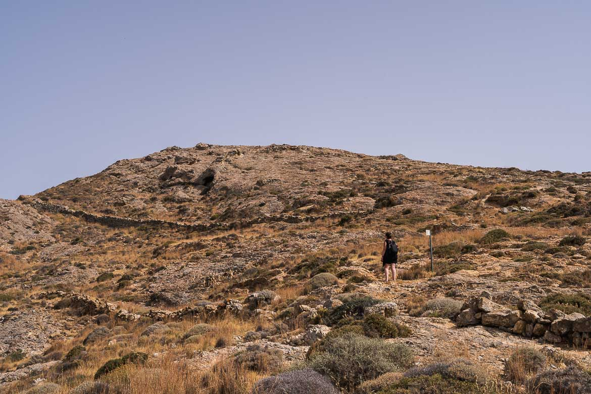 This image shows Maria standing at the starting point of the the miners road, near Chora.