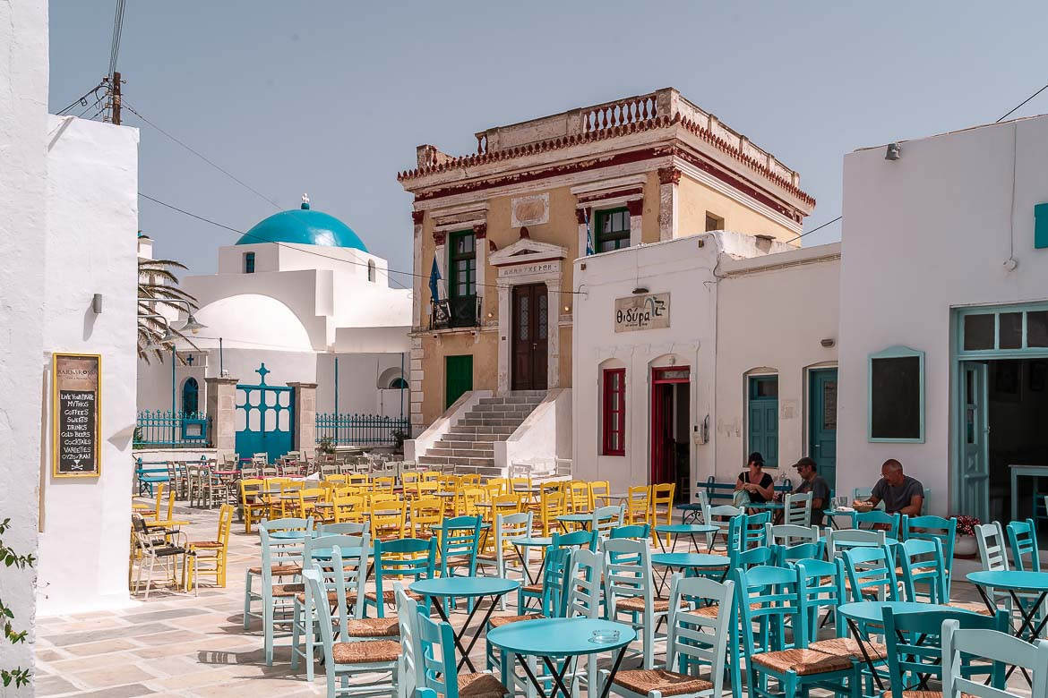 This image shows Pano Piatsa, the Upper Square, in Ano Chora. Hanging out at this colourful square is one of the best things to do in Serifos.