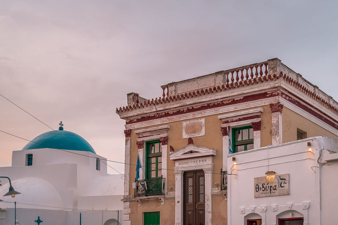 This image shows the neoclassical building of the Town Hall in Pano Piatsa at sunset.