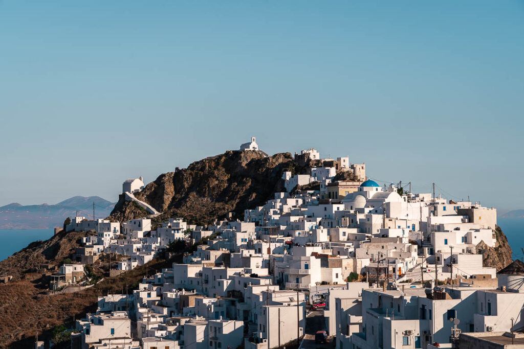 This image shows a panoramic view of Ano Chora. This is the featured image of our article: 15 Unique Things To Do in Serifos, Greece's Iron Island.