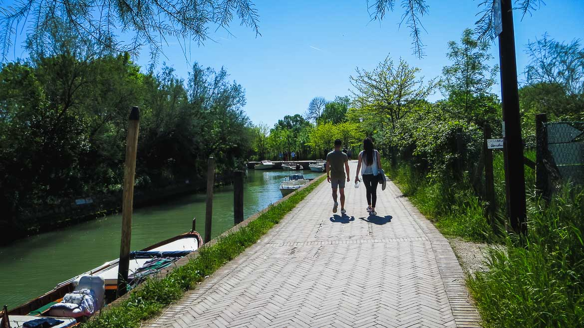 This is a photo of the single walkway in Torcello, Veneto, Italy. Venice Islands: The perfect Venice day trip.