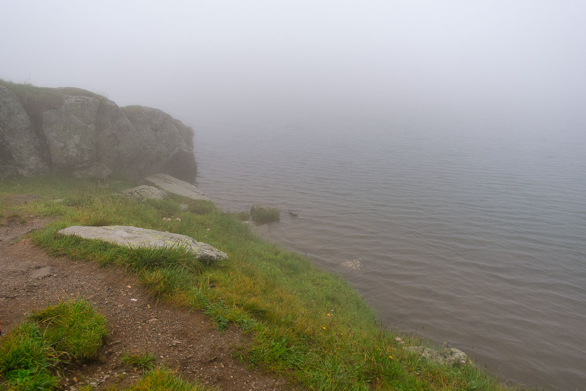 This photo shows the point where land meets water at Balea Lake. We had to get that close to the water to actually see it. Everything else around is covered in thick fog.