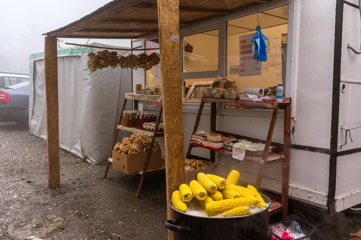 This is a photo of a food stall near Balea Waterfall. It sells boiled corns and local bagel-like treats.