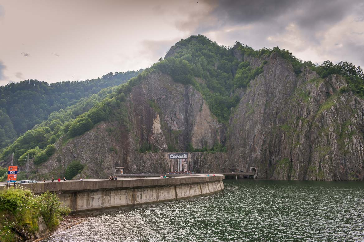 This is a photo of Vidraru Lake and Vidraru Dam on a cloudy summer day.