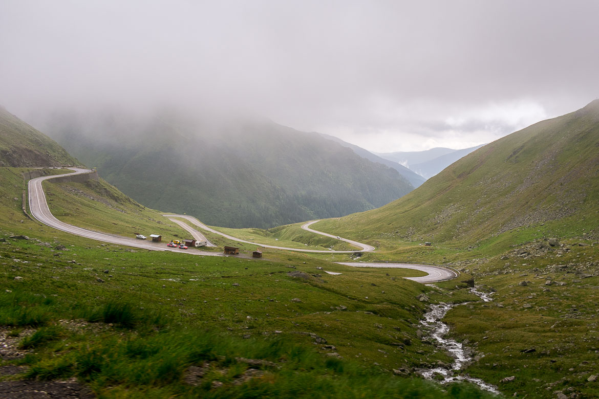 This is a photo of the famous Transfagarasan hairpins. The scenery is stunning. Everything is green and only the road interrupts the natural surroundings.