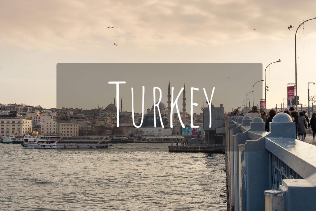 This image shows the Galata bridge in Istanbul with the iconic fishermen standing above the Golden Horn. It's the cover photo of Turkey as a destination.