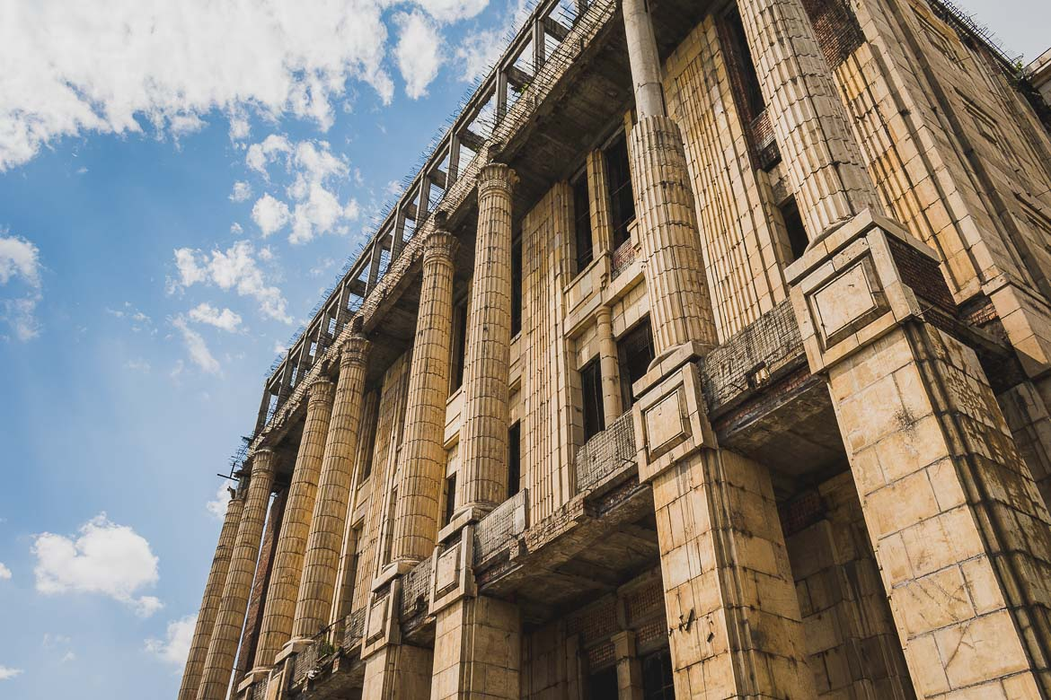 This photo shows the unfinished Romanian Academy we saw during our Bucharest walking tour of Communism in Romania.