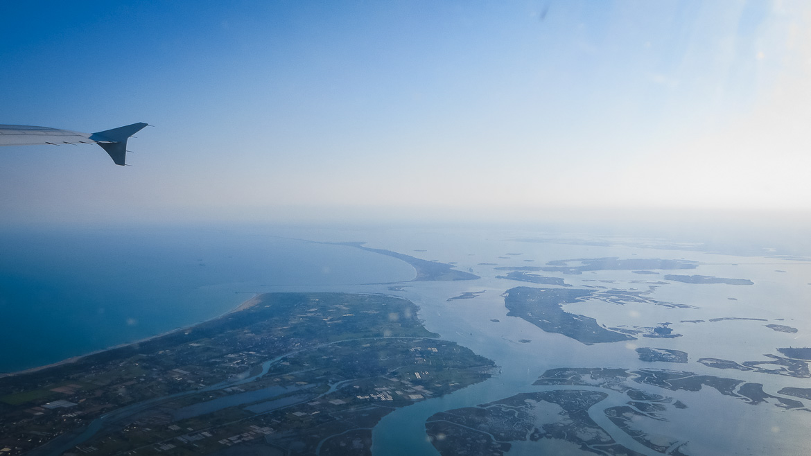 This is a photo of the Venetian Lagoon taken from the plane. Venice Islands. The perfect Venice day trip. Veneto Italy.
