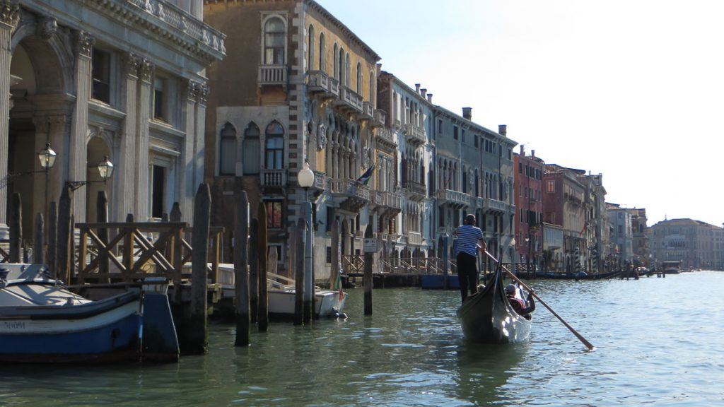 This is a picture of a gondola ride in the grand canal, venice, italy. One of the top things to do in venice.