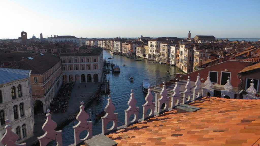 This photo shows the view of Venice and the Grand Canal from T Fondaco dei Tedeschi. What to do in Venice: our complete guide to La Serenissima. Venice Italy.