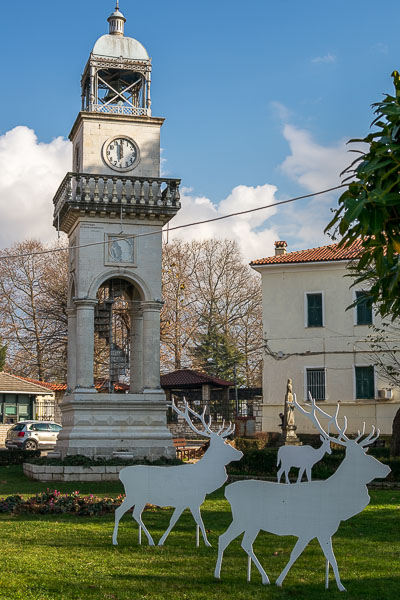 This photo shows the clock of Ioannina, one of the city's landmarks. There are raindeer decorations in front of it.