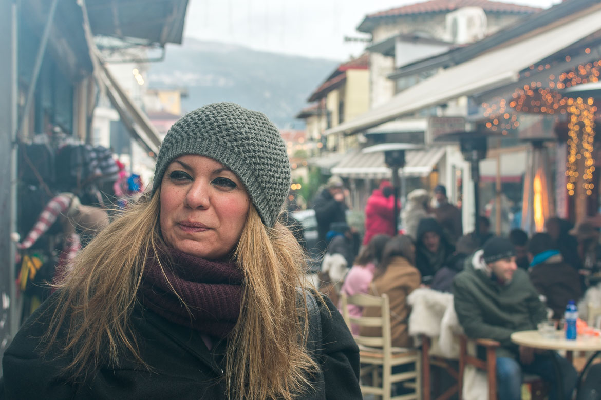 This photo shows Maria making a half-funny half annoyed face at the smell of grilled meat that conquers Ioannina.