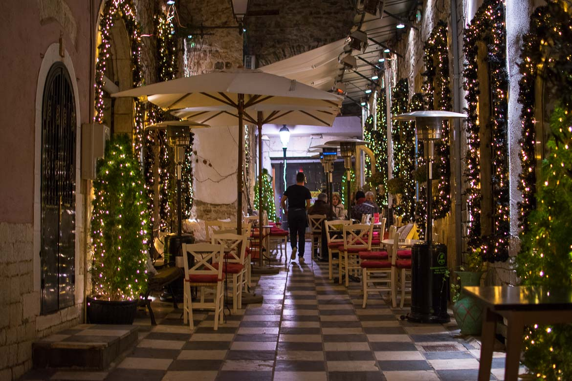 This photo shows one of the arcades in Ioannina Old Town charmingly decorated for the holidays. We've chosen this photo to be the featured image for our article Why visit Ioannina Greece on New Year's Eve.