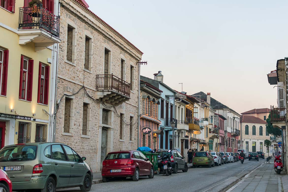 This photo shows a street in Ioannina Old Town lined with colourful buildings.