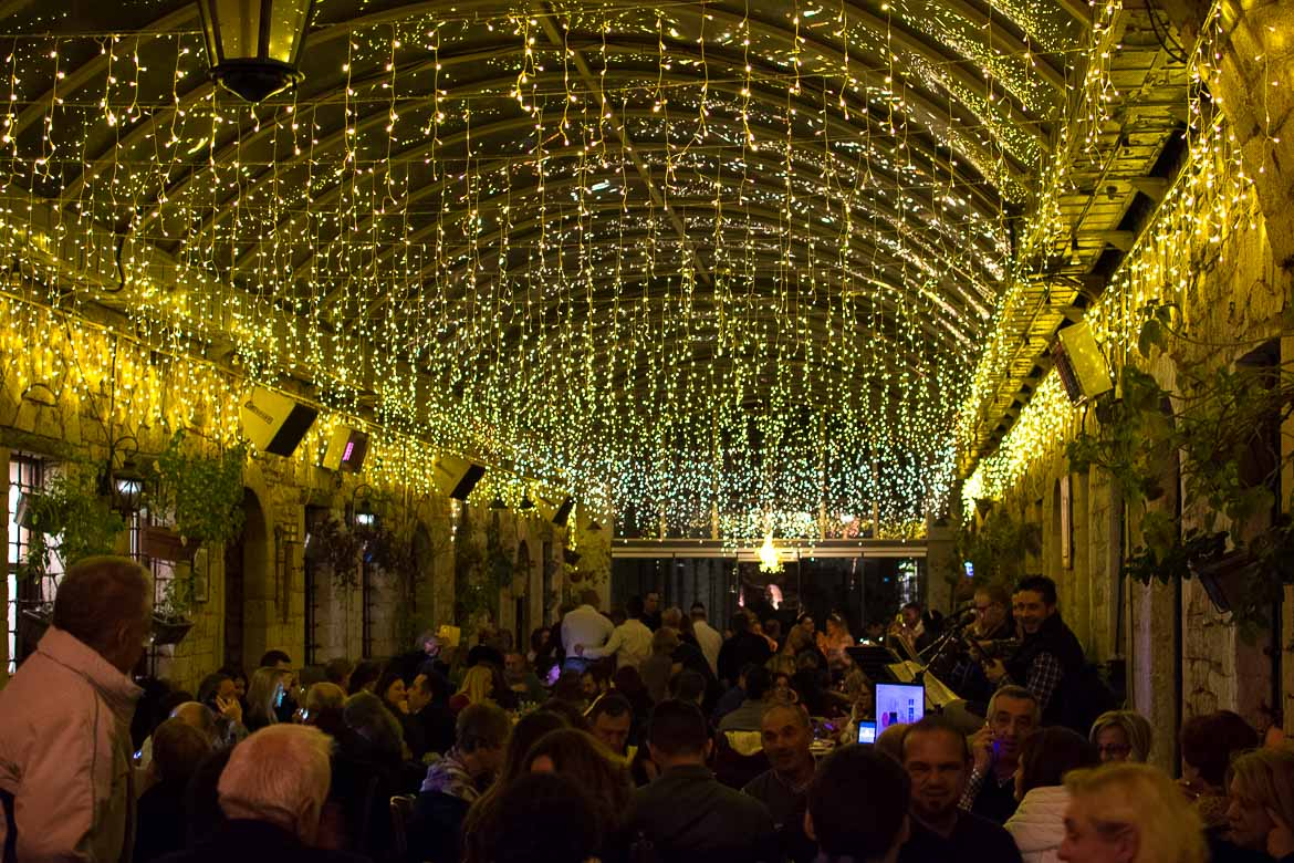 This photo was shot inside the restaurant at Stoa Louli. The restaurant area is decorated with countless Christmas lights and it is packed with people celebrating. Enjoying a festive night out is one of the main reasons why you need to visit Ioannina Greece on New Year's Eve.