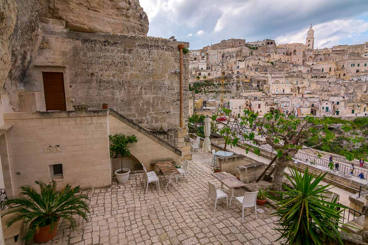 This image shows the beautiful terrace at La Corte dei Pastori B&B in Matera. The terrace has magnificent views to the Duomo of Matera and the Sassi.