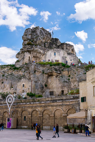 This image shows the complex of Santa Maria de Idris and San Giovanni in Monterrone churches. The churches are built atop Monterrone Cliff and provide an imposing spectacle in Matera Old Town.