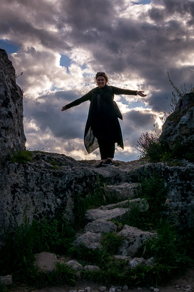This is an image of Maria happily standing on a rock at Murgia Timone.
