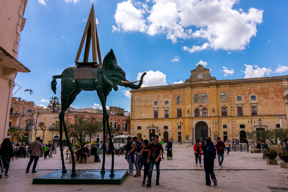 This image was shot in Piazza Vittorio Veneto. In the background, the magnificent Annunziata Palace. In the foreground, the bronze statue of Dali's Space Elephant.