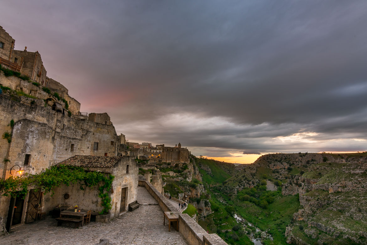 This photo shows the sassi and the ravine at sunset.