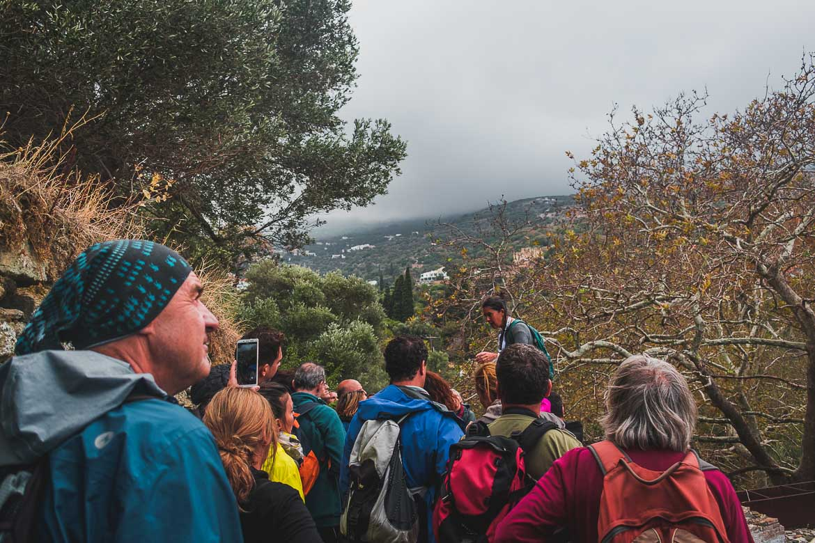 This photo shows a group of hikers listening to Olga Karagiannis explaining the story behind the Fabrika watermill during the 1st Andros On Foot walking festival.