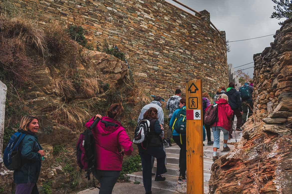 This photo shows hikers walk along route 8 at the 1st Andros on foot walking festival. A hiking event in Greece.