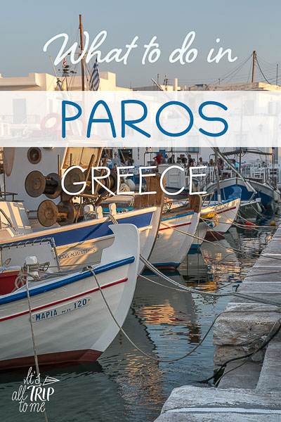 This image shows traditional fishing boats lining the old port of Naoussa in Paros at sunset. This is an optimised image for Pinterest. There is overlay text that reads What to do in Paros Greece.