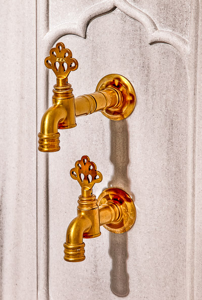 This image shows two golden taps at Kilic Ali Pasa Hamami in Istanbul.