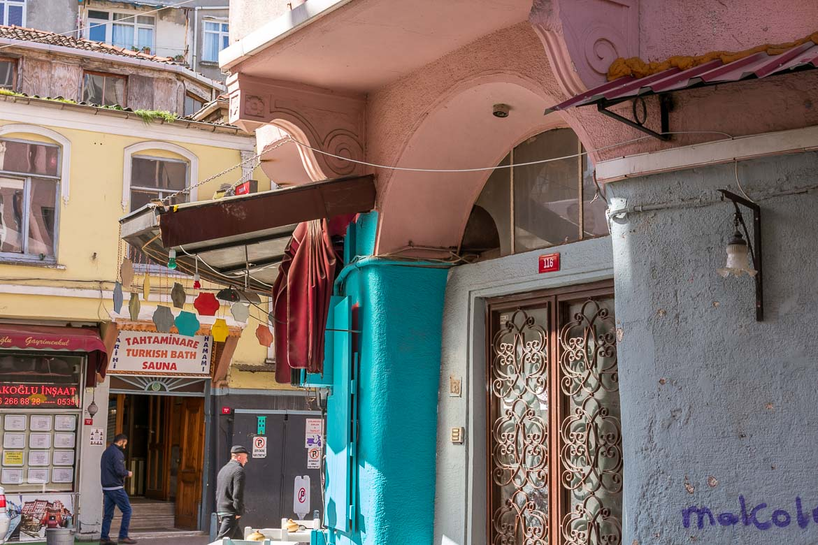 This image shows a colourful neighbourhood in Balat, Istanbul. There is a Turkish bath and sauna sign in the background.