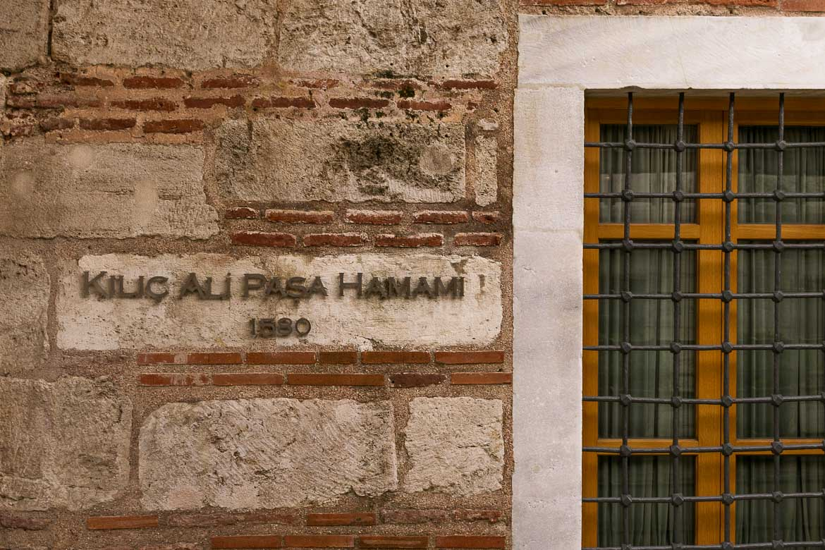 This image shows the sign outside Kilic Ali Pasa Hamami in Istanbul with the year that the hamam first operated (1580).