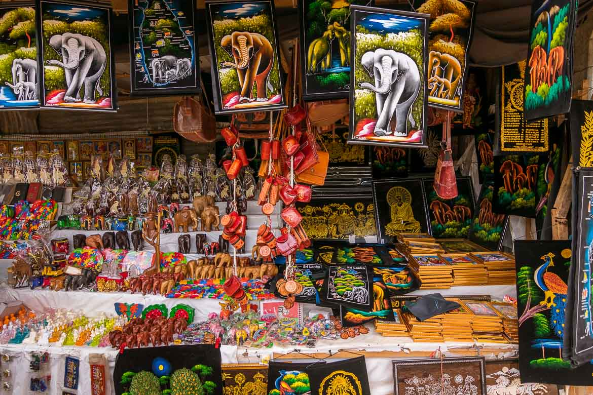 This photo shows an open air souvenir shop in Trincomalee Sri Lanka. There are many items on sale, most of them elephant themed. There are batik with elephants, wooden elephants, fridge magnets etc. We chose this photo as the featured image for our article: What to buy in Sri Lanka: 11 amazing gift ideas