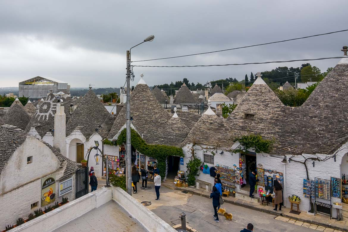 This is a panoramic view of Alberobullo and its trulli rooftops. This type of building with a conical roof is unique to Puglia.
