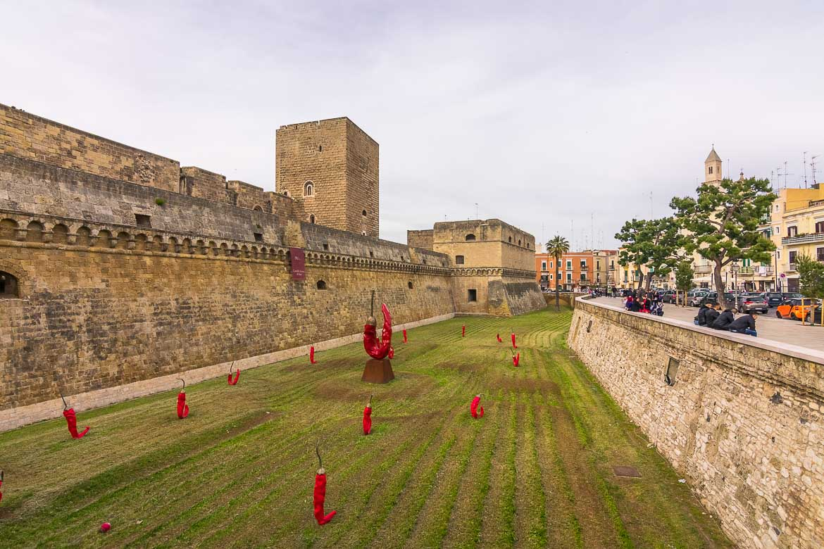 This image shows the moat of Bari Castle. It's covered with green grass and adorned with red chili peppers. We're assuming that was some kind of installation or exhibition.