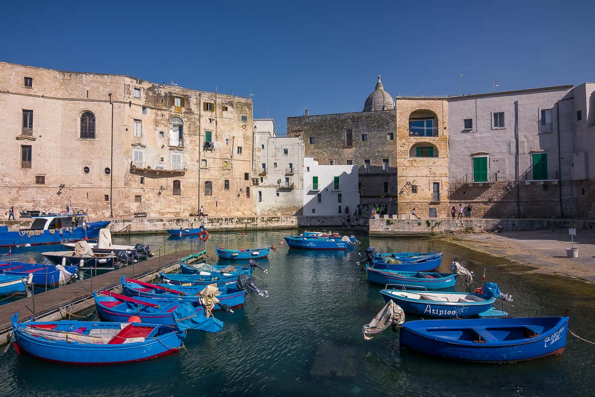 This image shows the old port of Monopoli with the iconic blue fishing boats. If you're wondering what to do in Bari during a longer trip, you should definitely take a day trip to Monopoli.