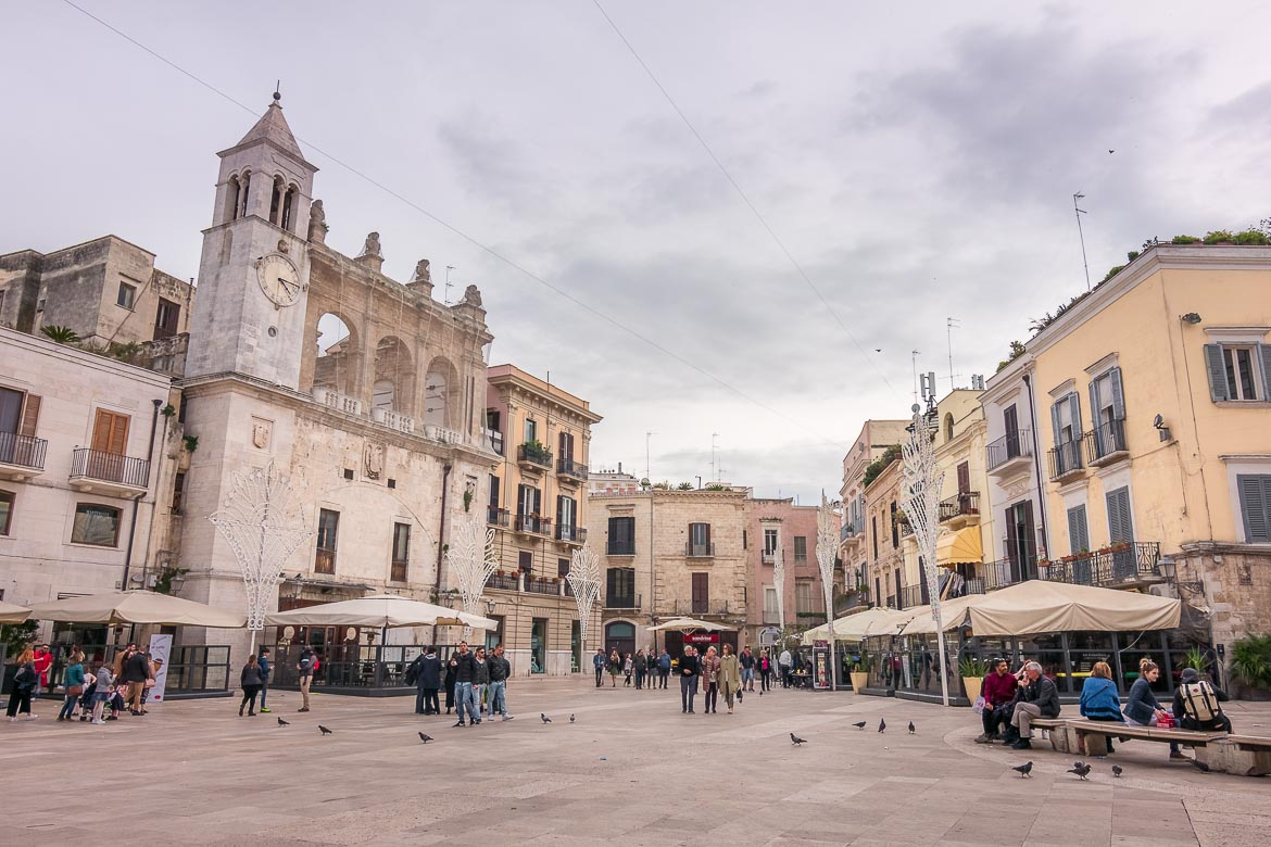 This is a panoramic shot of Piazza Mercantile. There are many beautiful old buildings and people of all ages, mostly locals, hanging around. Spending time at this square is a fantastic way to blend with the locals and one of the best things to do in Bari Italy.