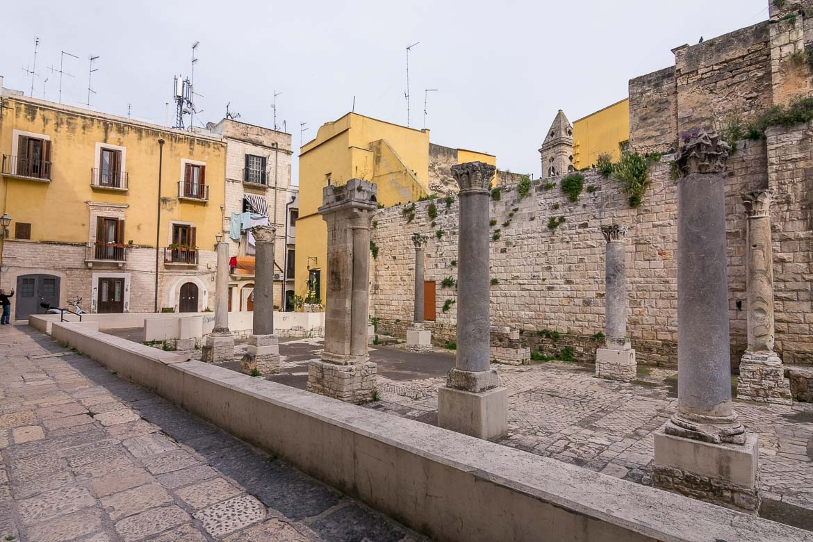 This is a photo of The ruins of Santa Maria del Buonconsiglio in Bari Old Town. There used to be a church on this site but it was demolished in an effort to excavate and preserve the Roman ruins that lay underneath. Nowadays, the ruins are utterly romantic and they are also the playground for local kids who use the site as a football field.