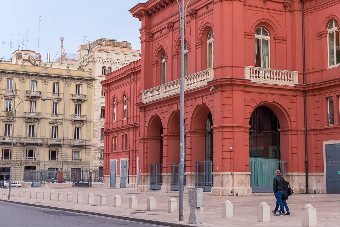 This is a close up of the bright red building of Teatro Petruzzelli in the evening.