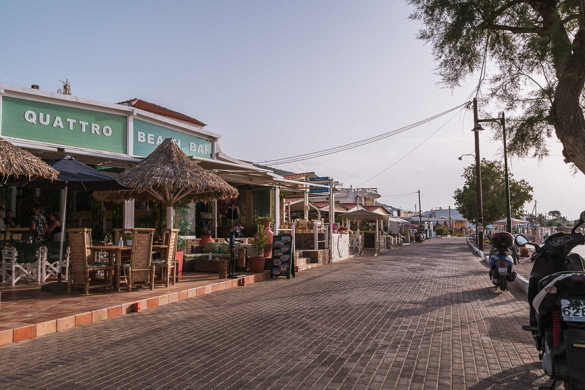 This image shows the seaside street that leads from Skala to Mylos. It's lined with many cafes and bars and it's the best spot to experience Agistri nightlife.