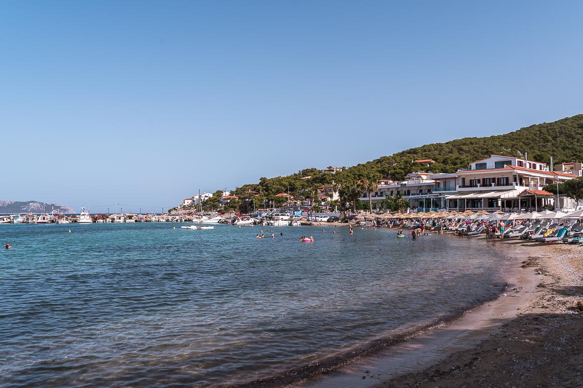 This is a panoramic shot of Skala Beach and Agistri Town.