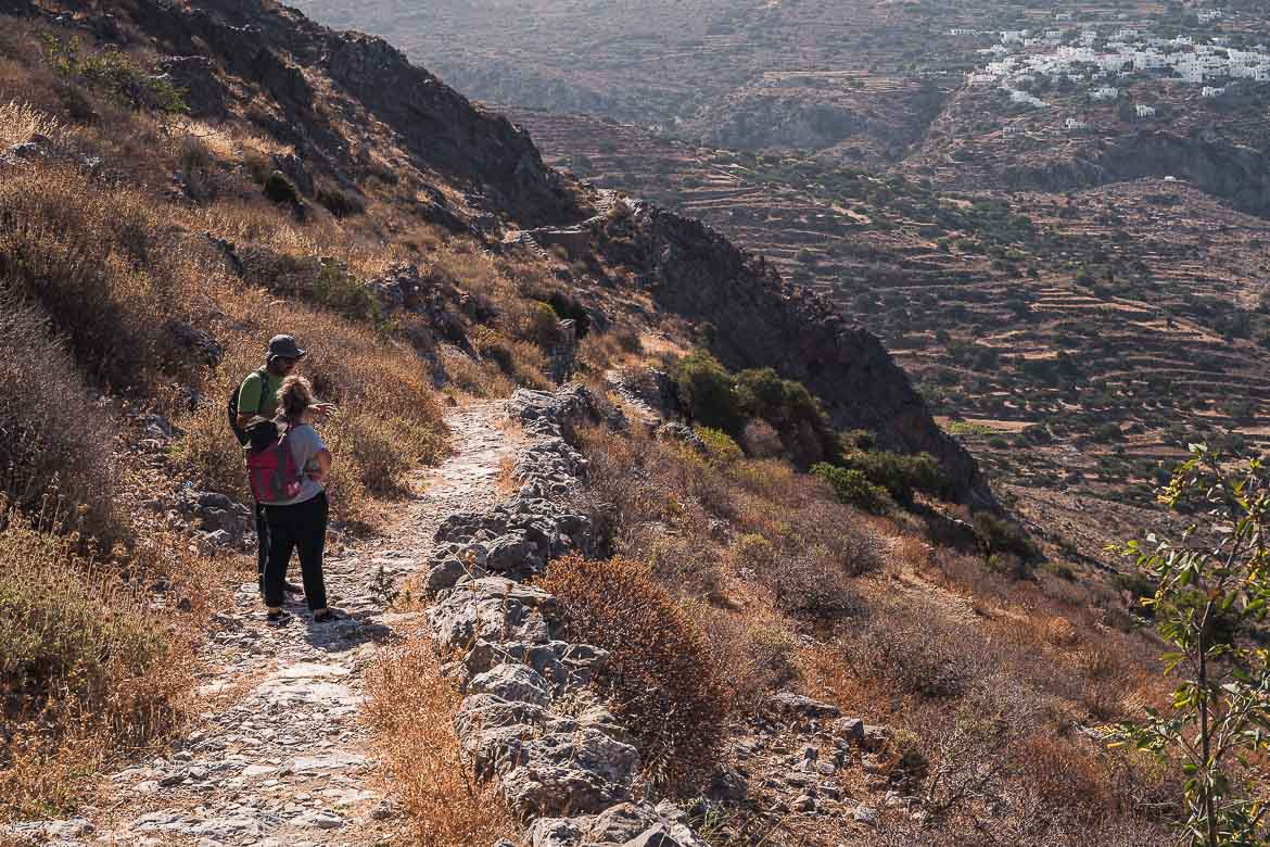 This images shows Maria and Antonis walking along an ancient path. Hiking is one of the best things to do in Amorgos.