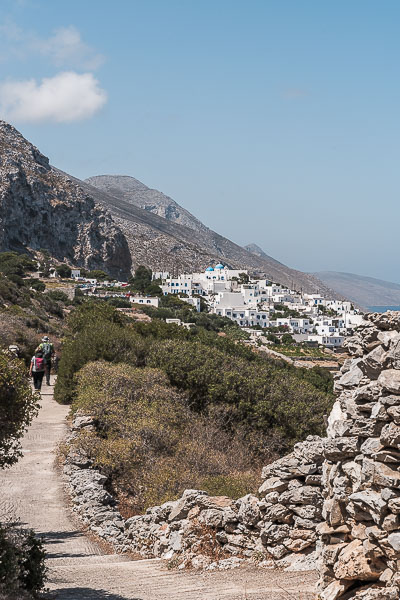 This image shows Maria and Antonis walking on the path just outside the whitewashed Langada village.