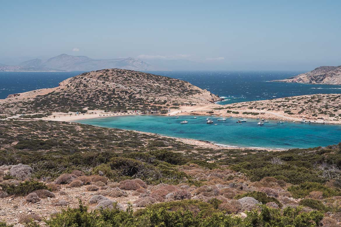 This is a panoramic shot of Kalotaritissa Bay with its turquoise waters and Gramvoussa Islet in the distance.